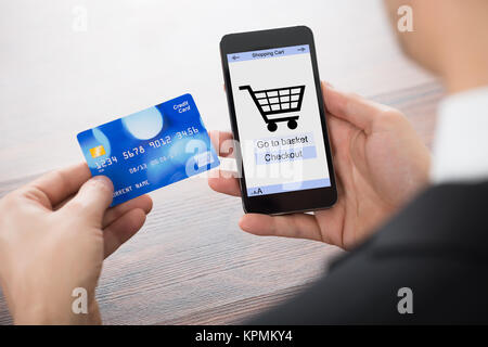 Businessman Shopping Online With Mobile Phone - Stock Photo