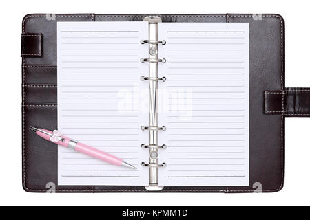 opened brown leather notebook and ballpoint pen - Stock Photo