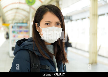 Woman wearing face mask for protection - Stock Photo