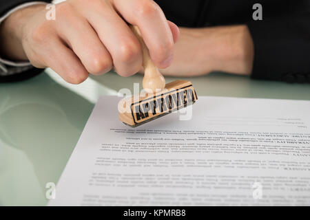 Businessman Hand Approving Document - Stock Photo