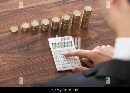 Businessman Using Calculator - Stock Photo