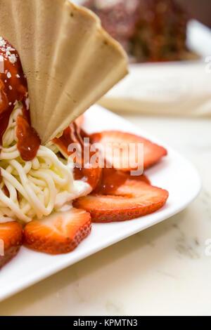 German ice cream made to look like a plate of spaghetti - Stock Photo