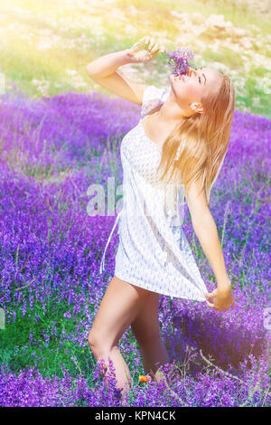 Beautiful woman on lavender field - Stock Photo