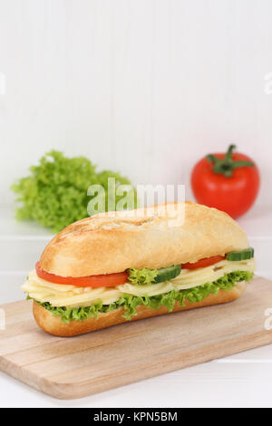 sandwich baguette topped with cheese and copy space - Stock Photo