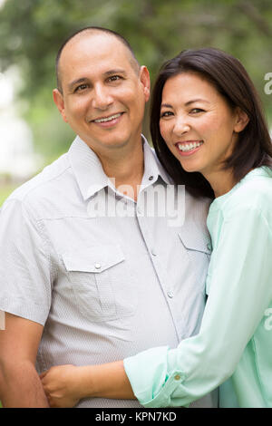 Happy couple smiling and hugging. - Stock Photo
