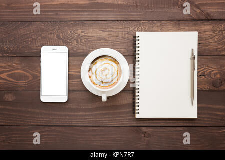 phone coffee and book blank on wood table top view - Stock Photo