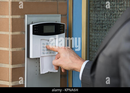 Close-up Of Businessperson Entering Code In Security System - Stock Photo