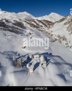 Little village covered with snow in mountain, Swiss Alps - Stock Photo
