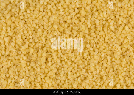 Couscous as background texture - Stock Photo