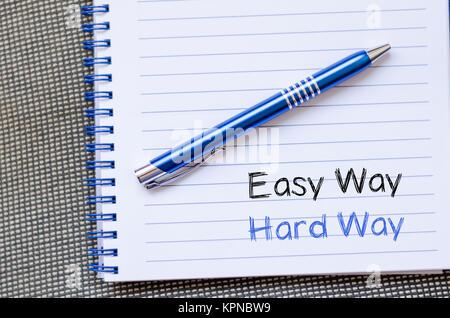 Easy way hard way write on notebook - Stock Photo