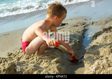 Boy Playing At The Beach - Stock Photo