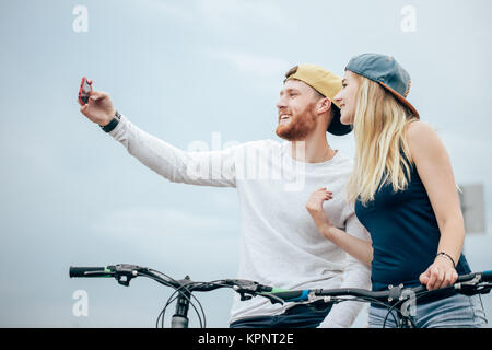 happy couple with bicycle taking selfie outdoors - Stock Photo