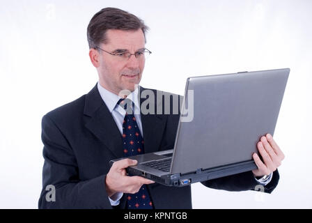 Model release , Geschaeftsmann, 50+, mit Laptop - business man with laptop - Stock Photo
