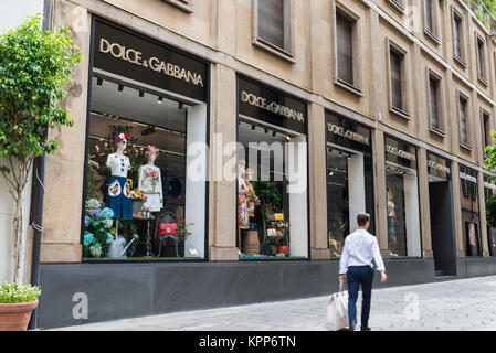 Milan, Italy - August 10, 2017: Dolce & Gabbana shop in a street of the Milan fashion district known as the Quadrilatero - Stock Photo
