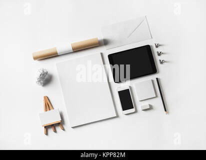 Brand identity mockup. Blank stationery set and gadgets at white paper background. - Stock Photo