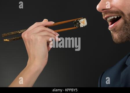 Feeding Man At Restaurant - Stock Photo
