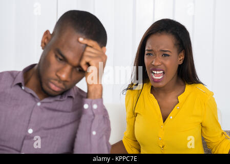 Woman Having Argument With Man - Stock Photo