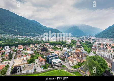 Bellinzona, Switzerland - May 28, 2016: Bellinzona cityscape view from castle under cloudy sky in Switzerland, surrounding - Stock Photo
