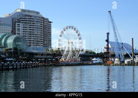 Dated 11 Dec 2017. View of Ferris Wheel at Darling Harbour in Sydney Australia. Darling Harbour skyline, skyscrapers, - Stock Photo