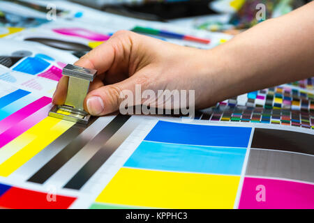 Printing Thread Counter Being Used by Female Hand Measurement Color Management Closeup Industry Object - Stock Photo