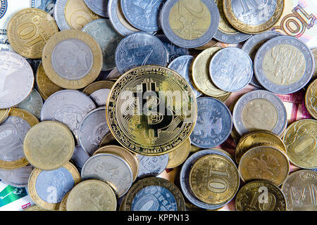 Bitcoin lies on top of cash coins. Crypto currency. - Stock Photo