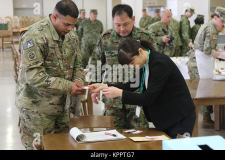 Master Sgt. Herman Hodges, 17th Field Artillery Brigade operations sergeant, receives his ballots for the Iron Chief - Stock Photo