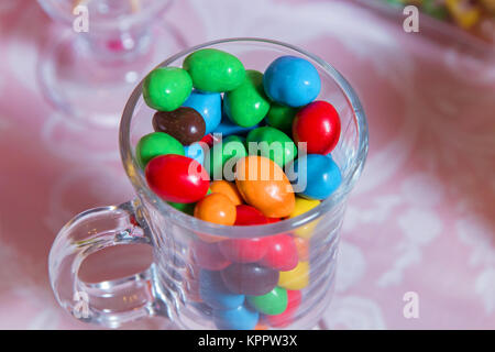 Multi colored sweets . Colored candy in a glass . Round chocolate is very colorful - Stock Photo