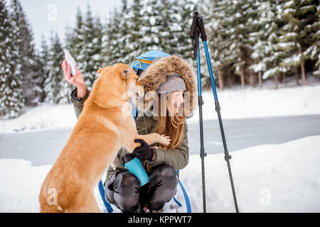 Winter hiking in the forest - Stock Photo