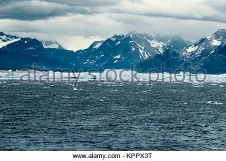 The southwest coastline of Greenland surrounded by icy waters - Stock Photo