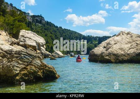 Sea kayaking near Split, Croatia - Stock Photo