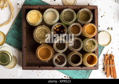 Closeup spices and herbs jars. Food, cuisine ingredients. Wooden box. - Stock Photo