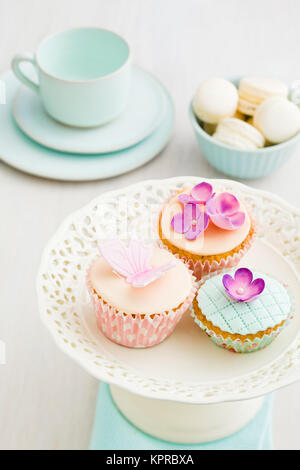 Cupcakes with flowers - Stock Photo