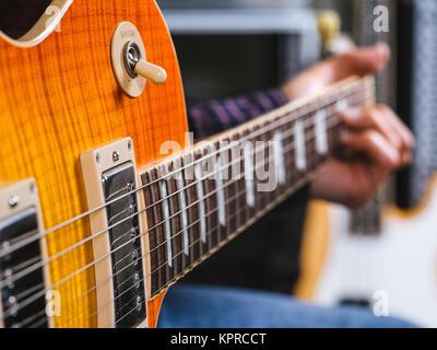 Closeup of playing the electric guitar - Stock Photo
