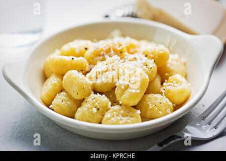 Gnocchi with parmesan - Stock Photo