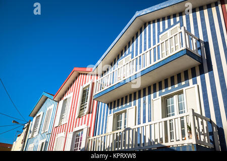 colorful striped fishermen's houses in blue and red,costa nova,aveiro,portugal - Stock Photo
