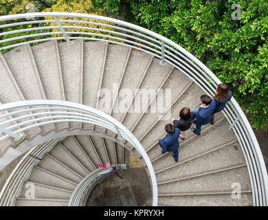 Top view of business people walking up to the staircase - Stock Photo