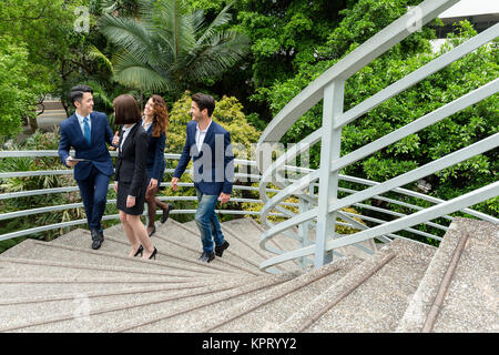Group of business people discuss at outdoor - Stock Photo