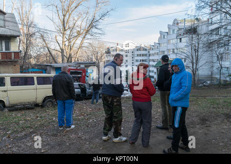 CHISINAU, MOLDOVA – DECEMBER 20, 2015: Unidentified people watching as firefighters stopped the fire from a burning - Stock Photo