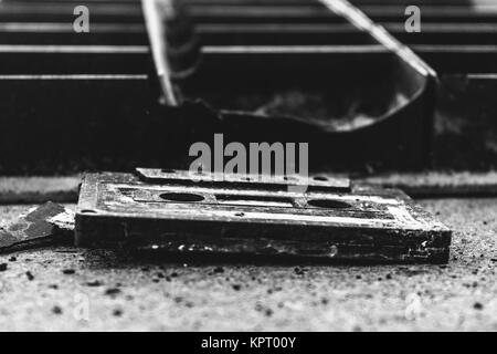 Old Compact Cassette with magnetic tape - Stock Photo