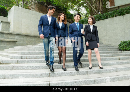 Group of business people walking down the stair case - Stock Photo