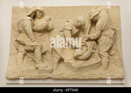 Carp fishing. Plaster relief by Czech sculptor Karel Hladík (1951) on display in the South Bohemian Gallery (Alšova - Stock Photo