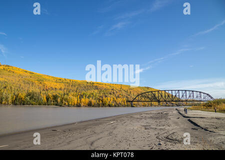 The Mears Memorial Bridge in the fall (autumn) on the Alaska Railroad spans the Tanana River at Nenana in Alaska, - Stock Photo