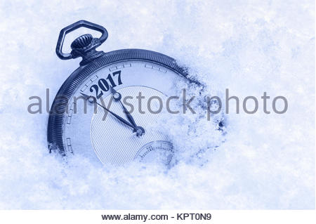 New Year 2017 greeting card, 2017 new year, pocket watch in snow, happy new year concept - Stock Photo