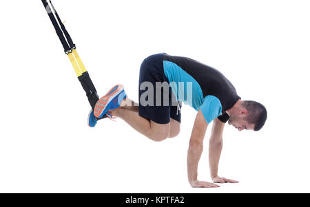 Athletic trainer on functional loops for training isolated on white background. - Stock Photo
