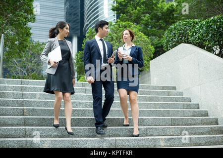 Business people walking outside office - Stock Photo