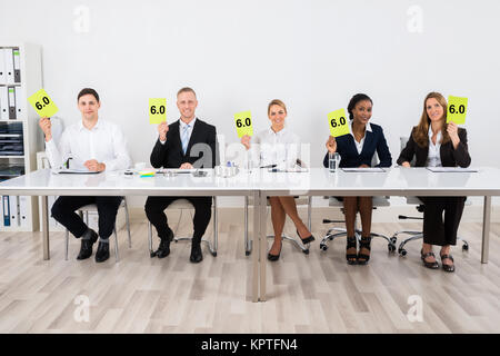 Businesspeople Holding Voting Paper - Stock Photo