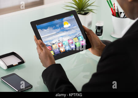 Businesswoman Holding Digital Tablet Showing Application - Stock Photo