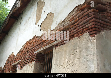 Destroyed concrete and brick wall on old building