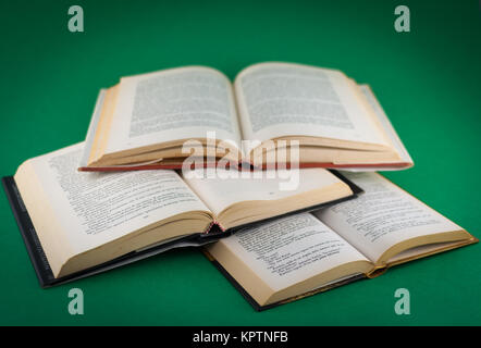 closeup of open books on colored background - Stock Photo