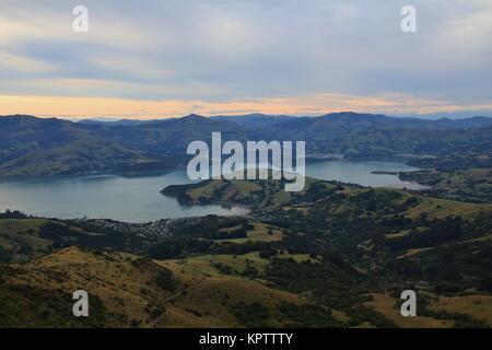 Peninsula near Christchurch, New Zealand. Distant view of Akaroa. - Stock Photo